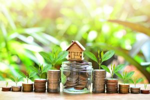 House,Model,On,Coins,Saving,For,Concept,Investment,Mortgage,Fund