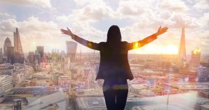 Young,Woman,Looking,Over,The,City,Of,London,At,Sun